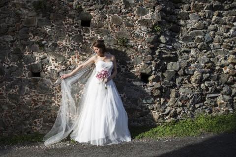 St. Thomas bride posing against a natural backdrop.