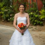 beautiful flowers and gorgeous bride ready for wedding photographs